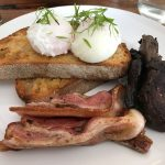Kodama Coffee Poached eggs on toast with bacon and mushrooms