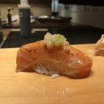 Salmon sushi with wasabi root salsa