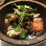 Wagyu beef topped with wasabi root salsa served in hot stone bowl
